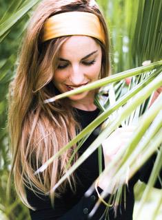 woman behind a palm leaf