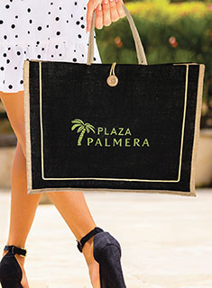 Woman carrying bag that says Plaza Palmera
